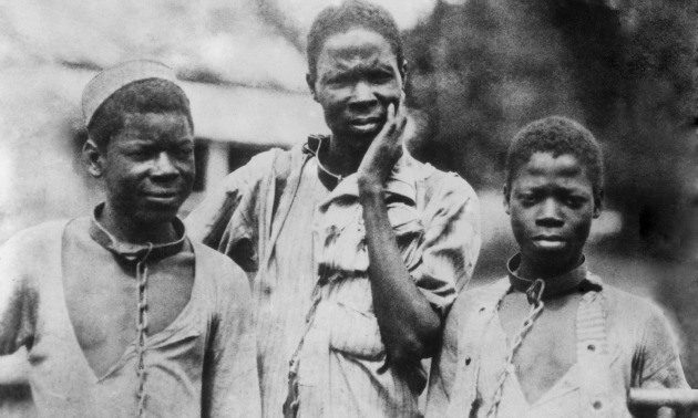 circa 1910: Three Abyssinian slaves in iron collars and chains. (Photo by Hulton Archive/Getty Images)